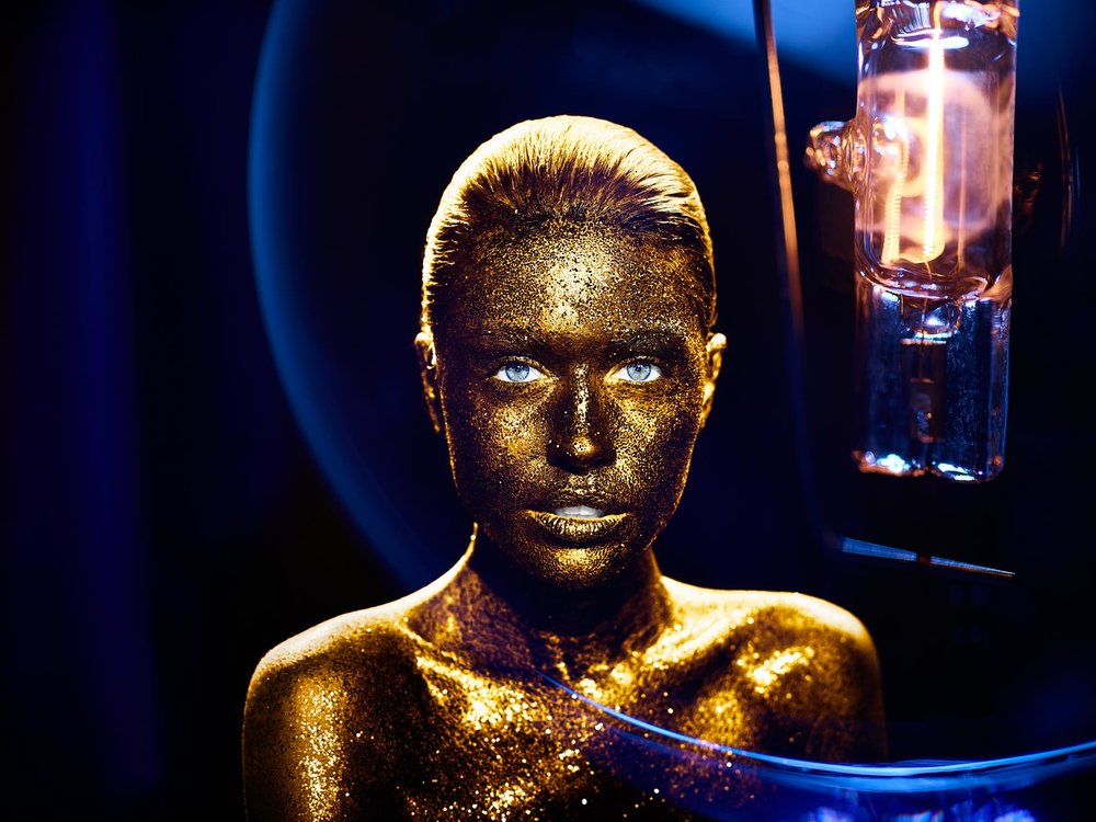 Mark DeLong - Beauty Photographer - Woman covered in gold glitter, blue eyes