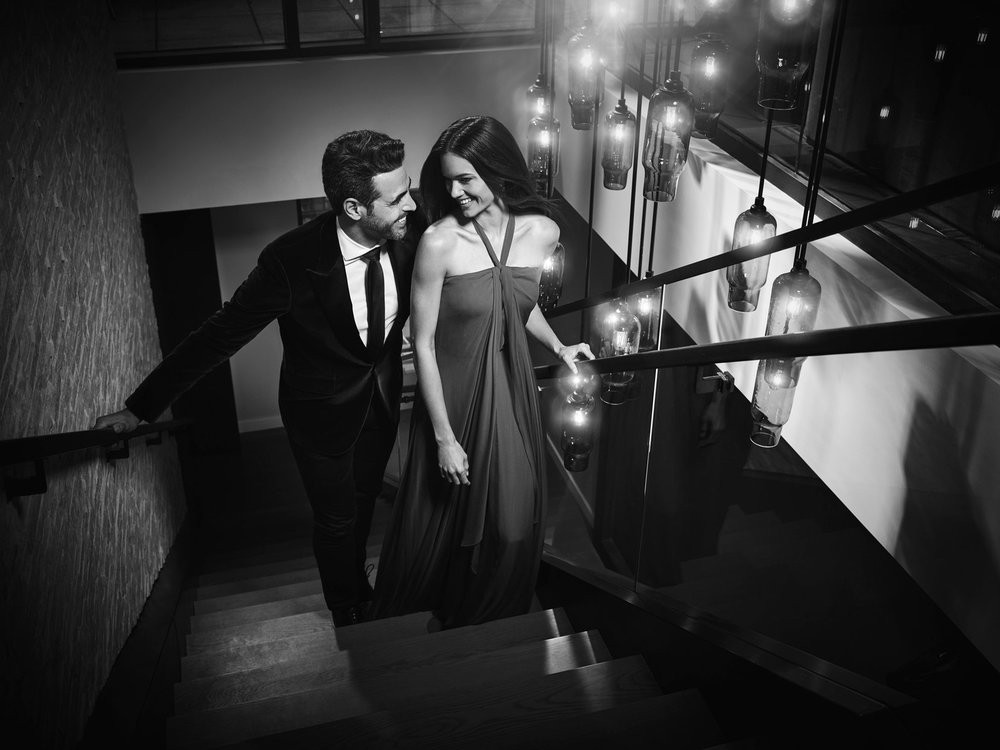 Mark DeLong - Commercial Photography - Couple walking up a flight of stairs.