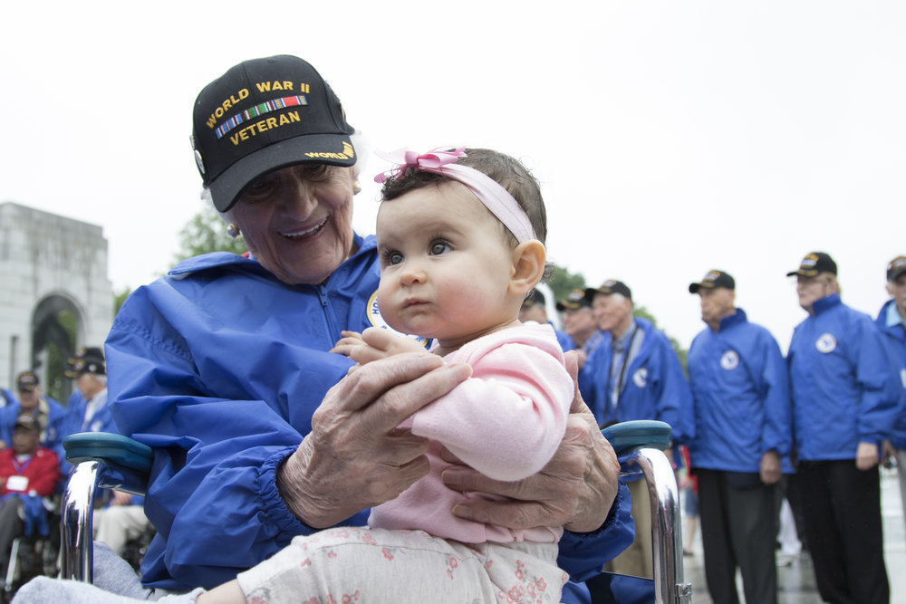 World War II veteran Susan Briggs, of South Carolina, hugs her great-granddaughter, Scarlett Briggs, 8-months-old, while touring the World War II Memorial in Washington, D.C., on May 11, 2016. Sixty-six World War II and Korean War veterans flew from Columbia, S.C., to Washington to tour the World War II Memorial and other major monuments. It was the last Honor Flight from Columbia.