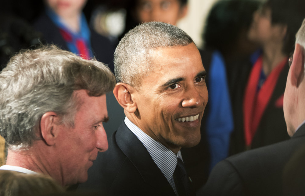 President Barack Obama chats with guests after publickly addressing at the 6th and his last White House Science Fair in Washington, D.C., on April 13, 2016.