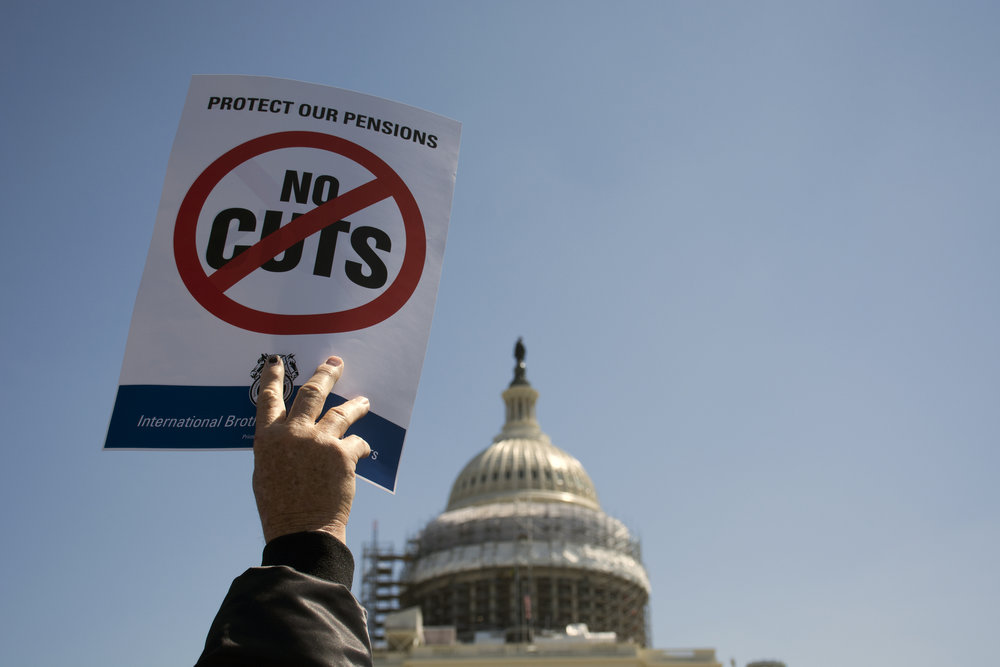 One of the signs brandished at Thursday rally to protest proposed pension cuts for retired teamsters in front of the U.S. Capitol on April, 14, 2016.
