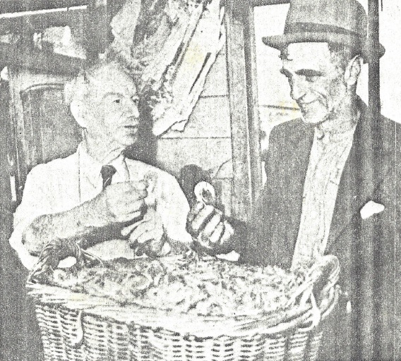 Hartley Spurr (left) inspecting a basket of prawns caught in the backwaters of Port Hunter by a local prawner.
