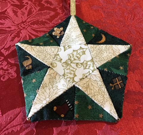 Here is the star turned back into a pentagon lying flat and easy to pack away til next year. How good is that ?