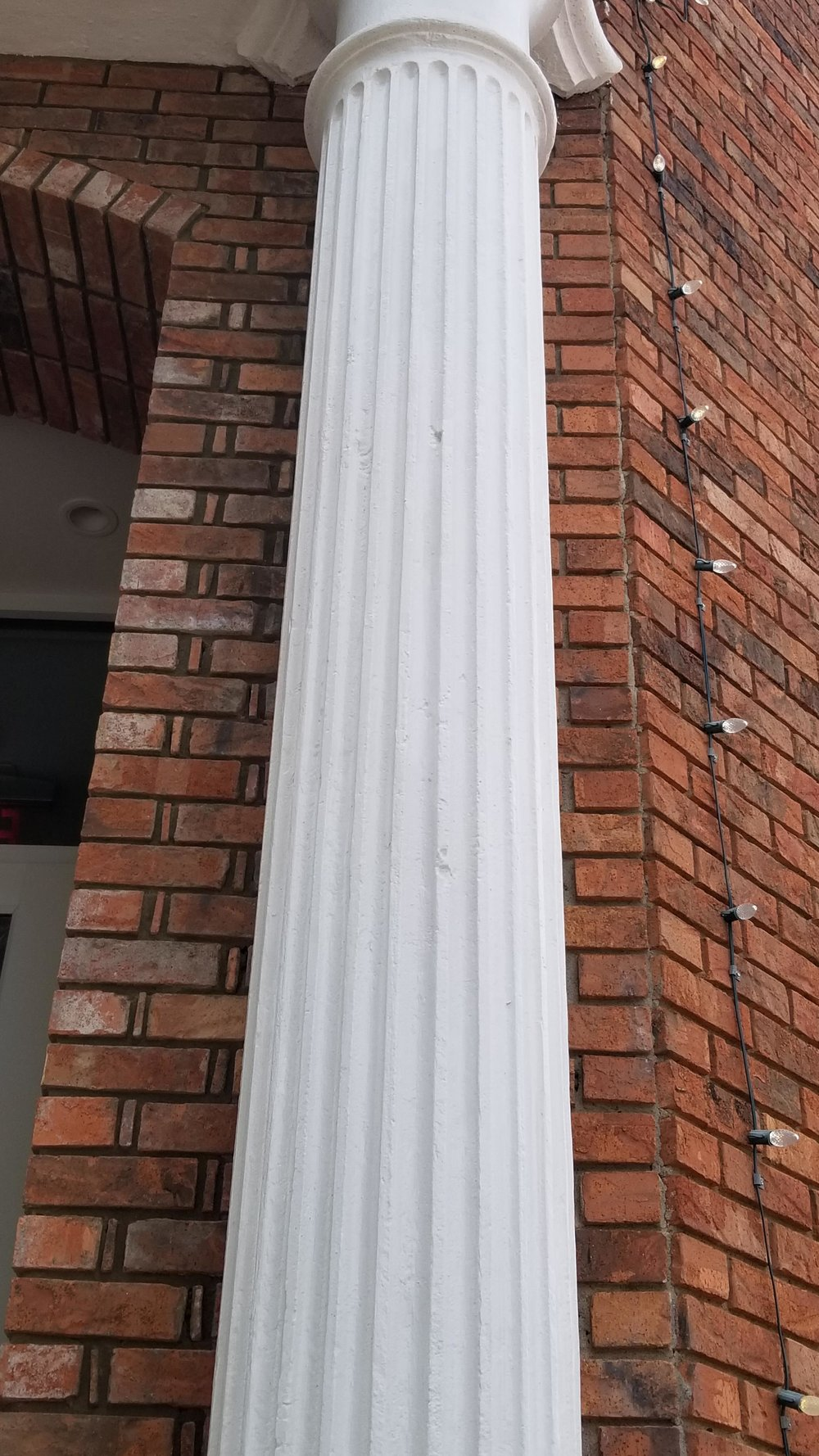 The bullet nicked iron pillar outside of the old People's bank, now Fiamma restaurant.