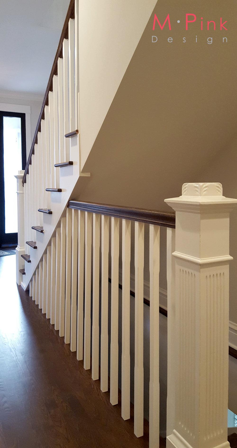 Stair rail detail. Repainted original newel posts.