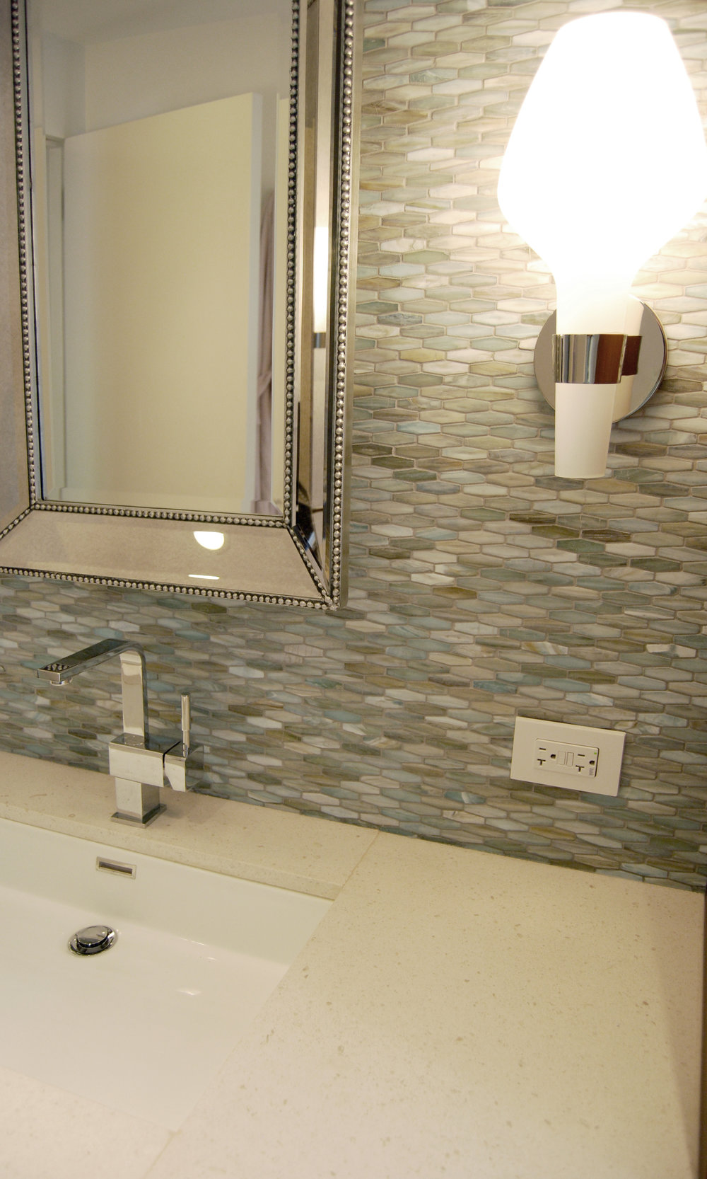 Eclectic mix of tile, plumbing fixtures, lighting and mirrors. Selected for a master bathroom in Hyde Park.
