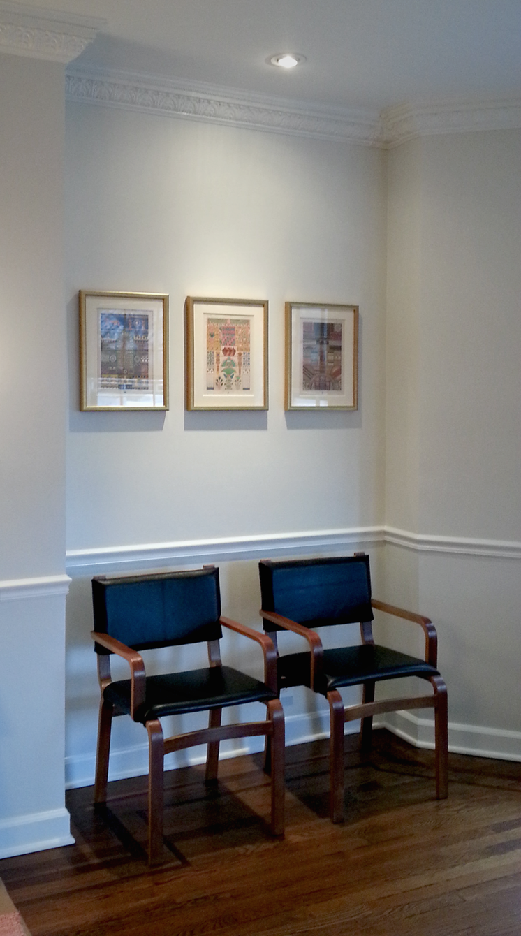 Recovered modern chairs. Artwork placement and hanging.