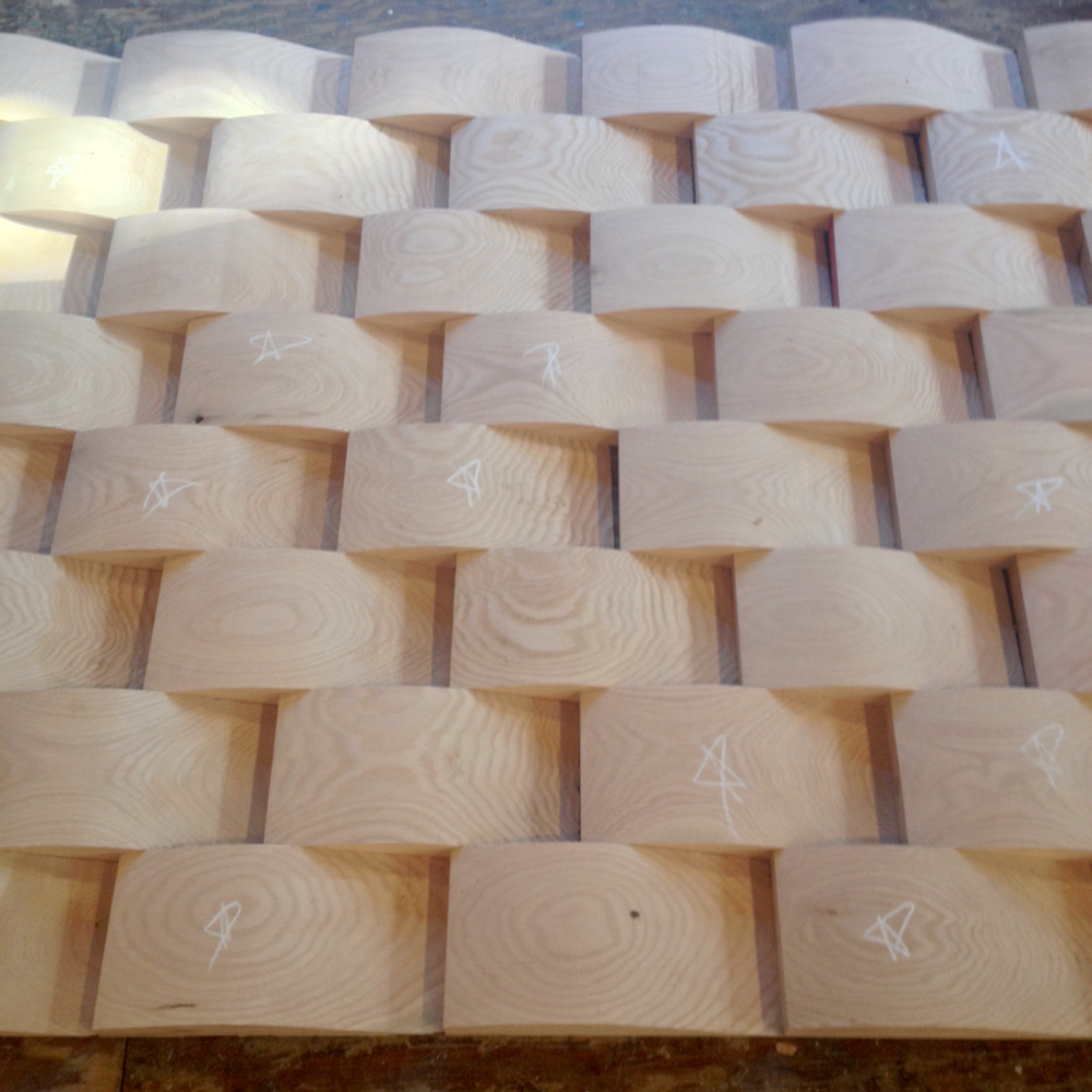 Curved wood blocks ready to be put together for a custom wood entry bench.