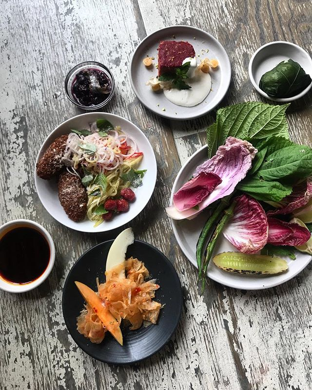 Serving set lunch @fourhorsemenbk today and tomorrow. Fuki sticky rice // beef tendon and melon // fried fish salad // all the herbs // blueberry and anchovy salsa // chili oil // beet cake and husk cherry #eatwithyourhands #realfood