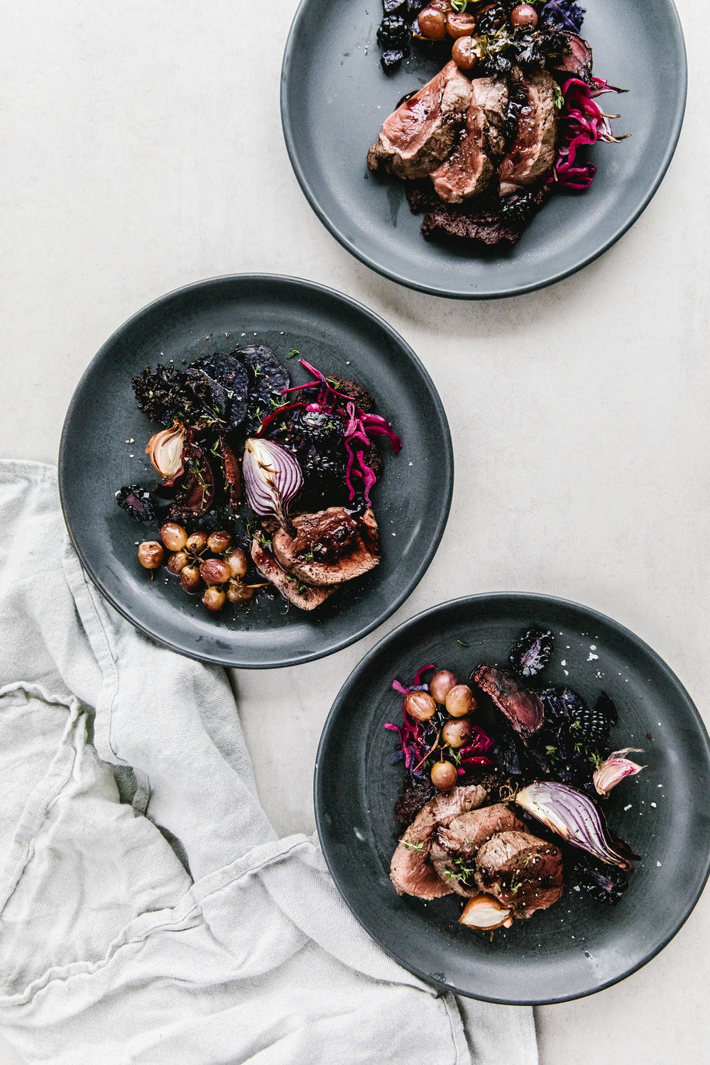 Venison With Red Cabbage, Roasted Grapes, and Wild Garlic