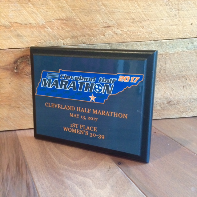 The 2017 plaques. 1st, 2nd, and 3rd place in 5 year age groups in the half marathon and 5k will earn a custom age group award plaque!