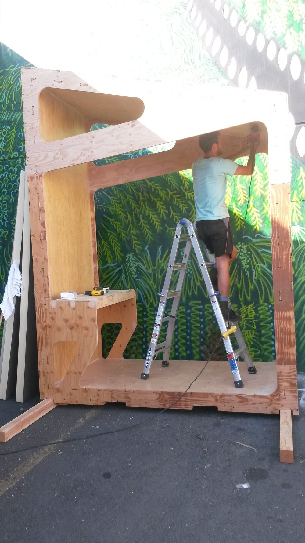 Noah from SERA Architects working hard to sand the inside of the pod. The goal is to have this segment completely finished by Sunday!