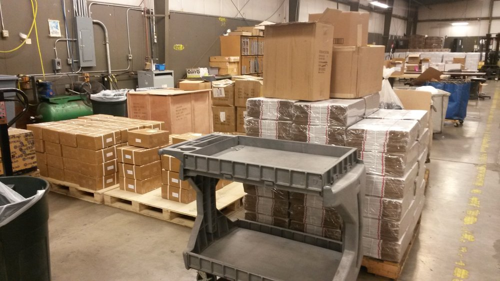 Pallets of our parts in the Exceed warehouse. From left to right, you can see the corner of the Arduino Shields, all the brackets, the wooden box of roller chain, boxes of cables, and a whole lot of medium flat rate boxes!