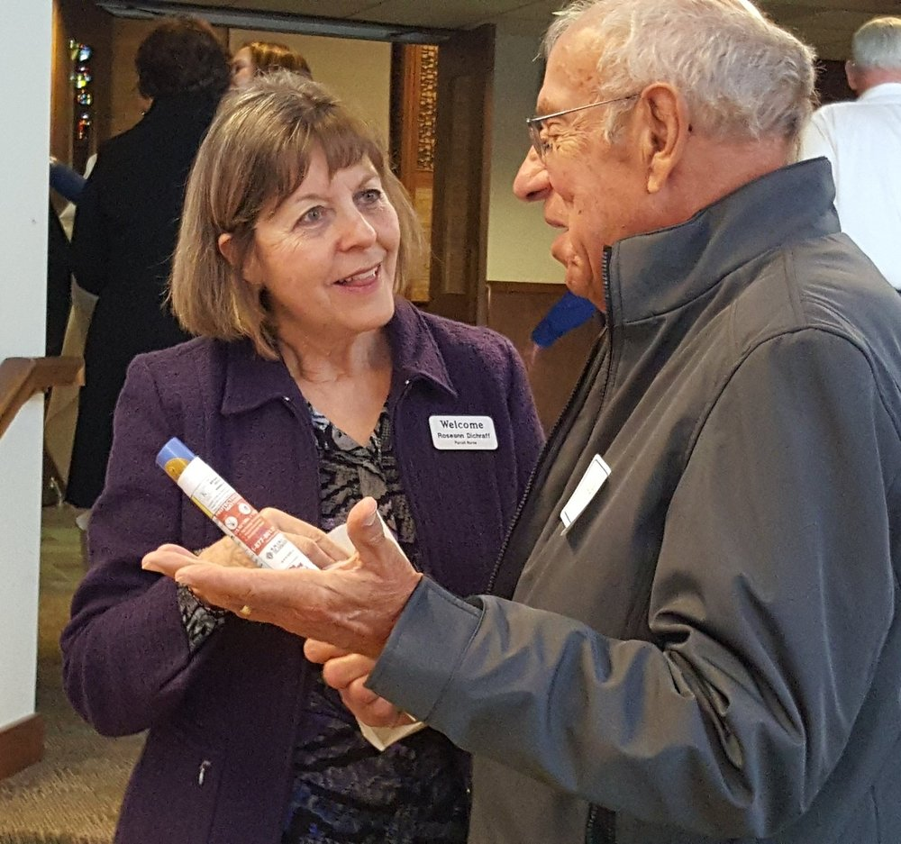 Parish Nurse, Roseann Dichraff listens to a parishioner during our Stewardship Renewal in 2016.