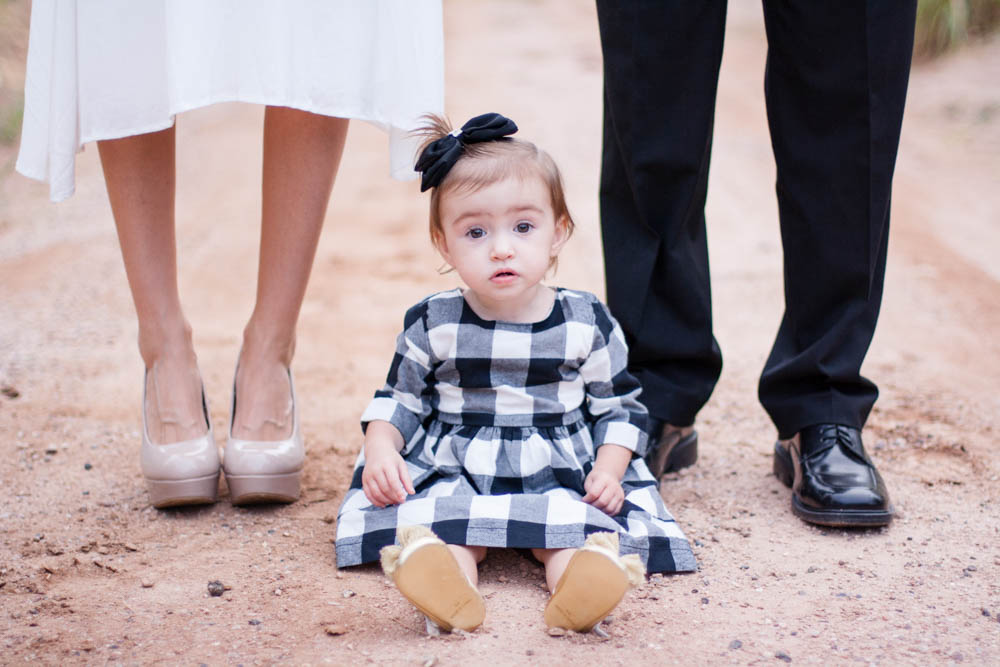 Style: Go for casual dressy/dressy    -Bring your own individual/unique taste to your pictures! It's best for parents to be neutral and kids to be a little more vibrant. Avoid the typical blue jeans and white t-shirt look. A good idea is to have boys wear nice pants/jeans and girls wear dresses.    -AVOID BUSY PATTERNS! A pattern can really date a picture. Keep it simple and avoid big trendy logos. Boys look great in a shirt with a collar, even if it's a golf shirt.    -Wear something that you have tried and tested. It has to be comfortable, it has to fit, and it has to boost your confidence. It shows in the pictures!    -Makeup. Put on some mascara, blush and lip tint as a minimum. Foundation and eye liner are a bonus! Lip stains are the way to go to give you a natural reddish pout that will last through the shoot. For guys: Brush your eyebrows and if you have dark circles under your eyes, dab some concealer under them. Be careful shaving to avoid nicks and wear a little lip balm for smooth lips.    -Hair. Natural is best! Avoid hats, unless it's something you wear every day and you really want to. Style your hair the day before. It looks more natural and less done. Spray fly-aways.    -Shoes. Nice shoes, NO FLIP FLOPS. Heels for mom look fantastic, but bring an extra pair of flats in case there are areas where you would sink! Also, avoid very worn looking shoes like tennis shoes or ones that are worn every single day.