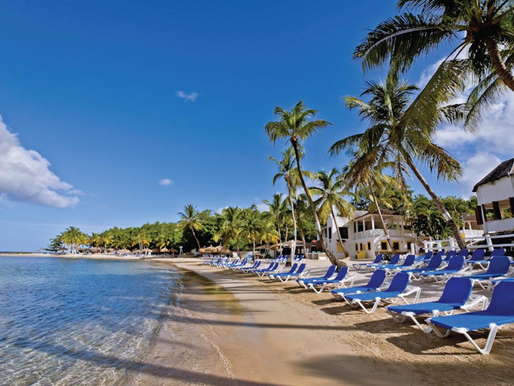 Windjammer Landing Villa Beach Resort på St. Lucia ligger på en nydelig strand i den vakre Labrelotte-bukten