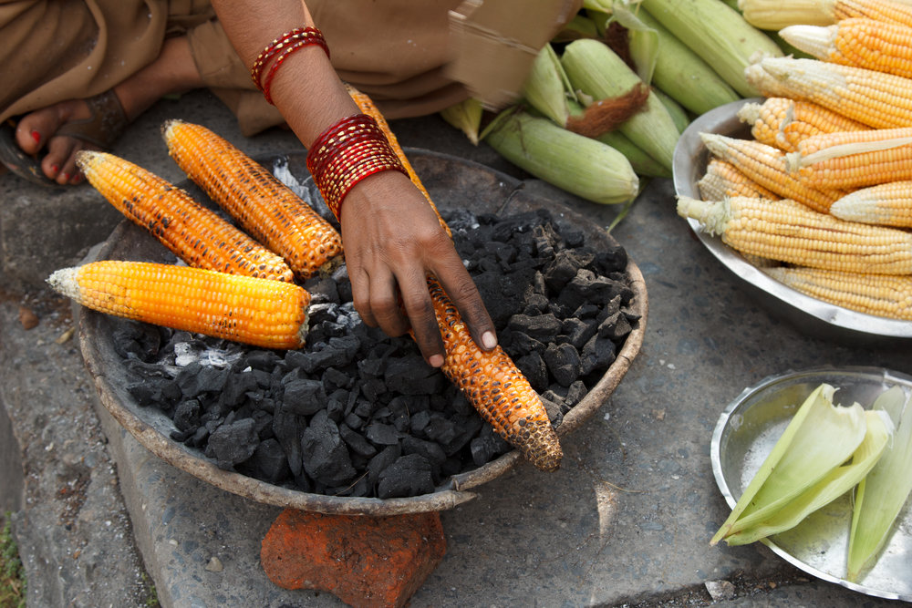 nepal_pokhara_bigstock-earn-of-corn-roasted-in-the-st-31995881.jpg