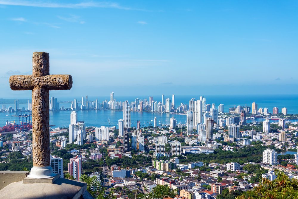 colombia_bigstock-Cross-And-Modern-City-56679803.jpg