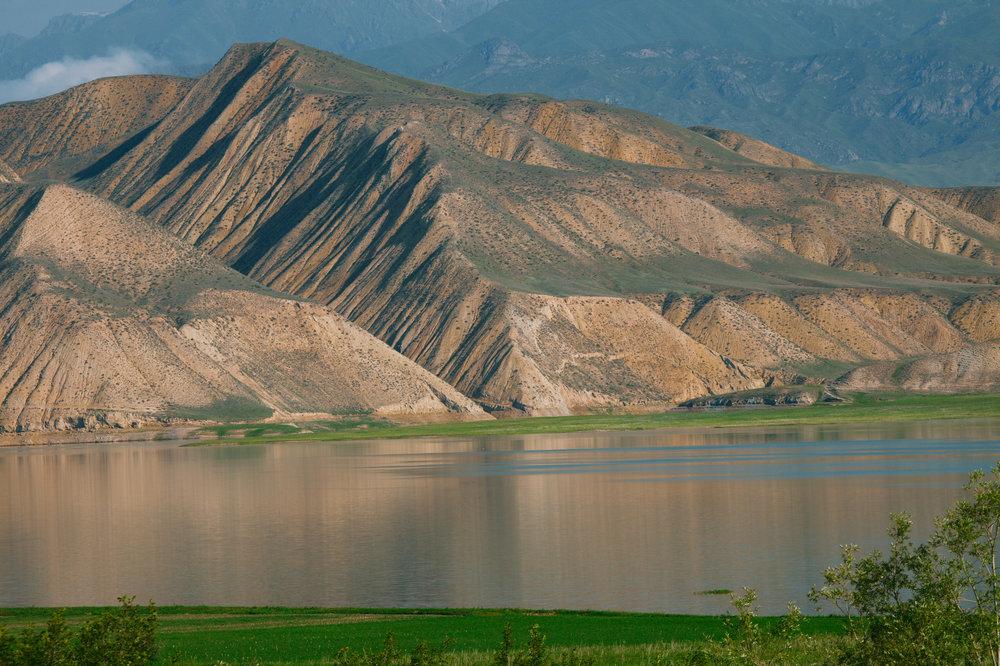 kysrgyzstan_bigstock-Toktogul-highland-mountain-la-195779827.jpg