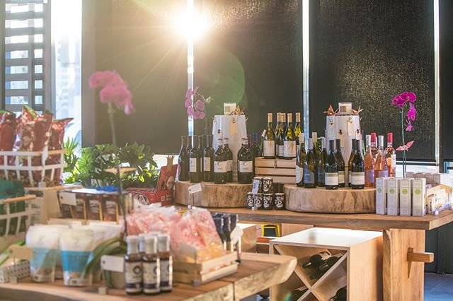 The XO market, fully stocked with grab n' go dishes, homemade pickles and sauces, and a curated selection of wine, juices and snacks.