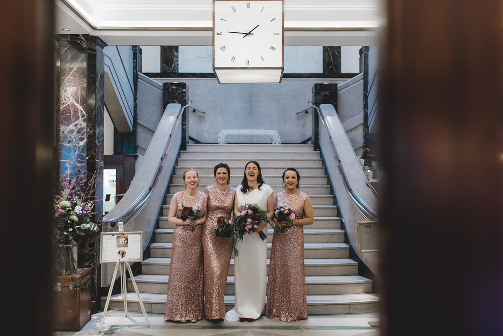 bridal party in lobby of town hall hotel
