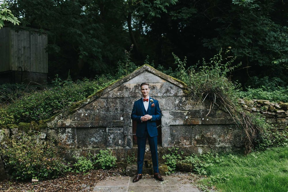 groom portrait at natural retreats