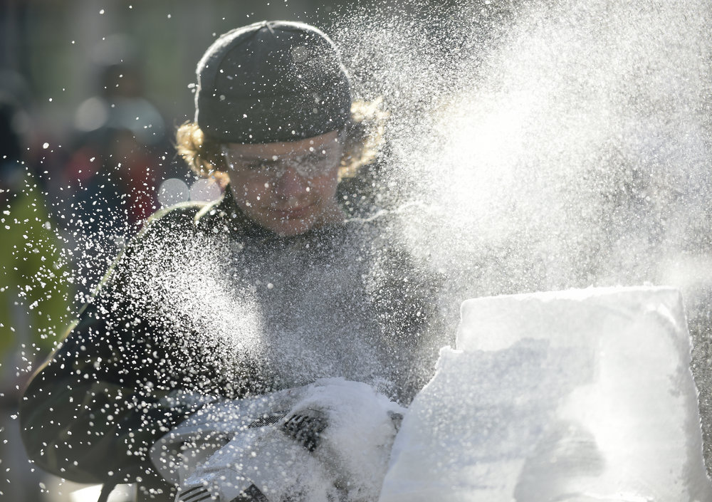 An ice carver goes head-to-head with other competitors at Reading Fire + Ice Fest.