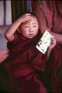 Bhutan Roskelley_Young Bhutanese monk with his Dali Lama photo 1986.jpg