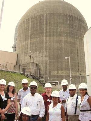 EHJ President Norris McDonald with tour group in front of Unit 3