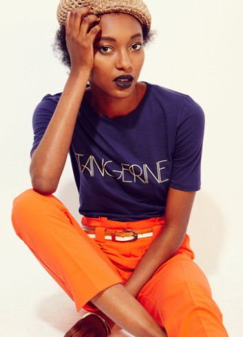 "Does the term ""Cuties"" mean anything to you? Navy t-shirt with orange straight leg pant."
