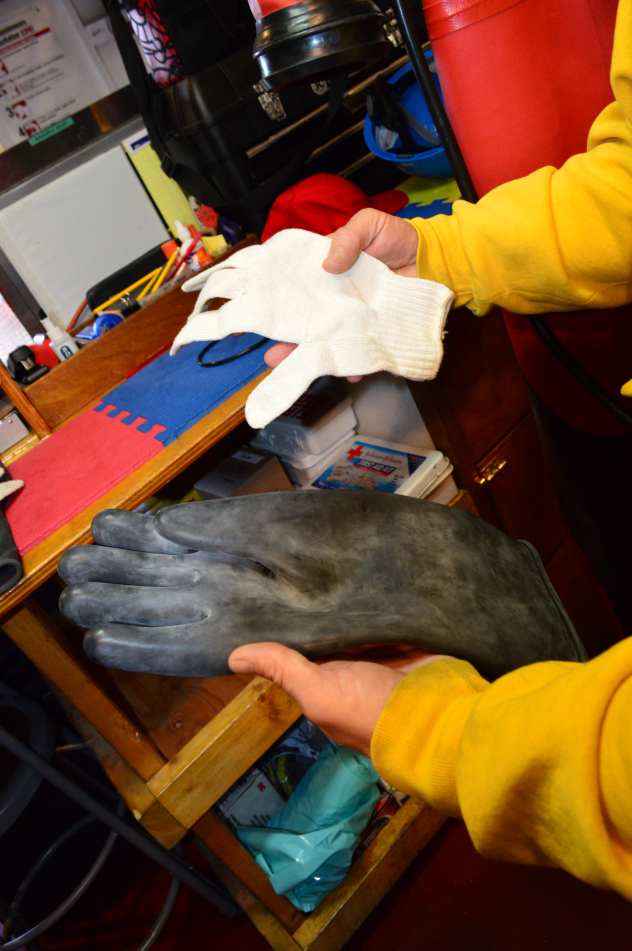 Demonstrating glove construction and layering for pressurized suits used in extreme environments, in this case deep underwater.
