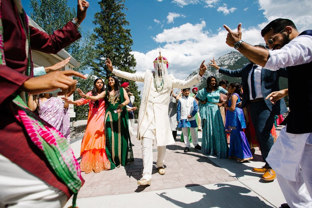 July6.RadCharan2571_Note Photography Photojournalistic Wedding Ben Nelms Documentary Photography Award Winning Rocky Mountain Banff Springs Hotel Fairmont Punjabi Indian Ceremony Baraat.jpg