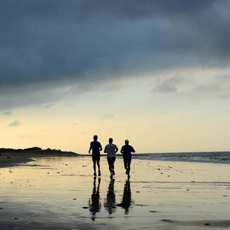 25821448-three-men-running-on-the-beach-at-sunrise-bay-of-bolonia-cadiz-province-andalusia-spain.jpg