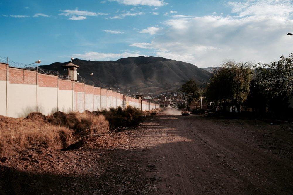 The women's prison in Cusco, in between a dirt road and the Andes mountains