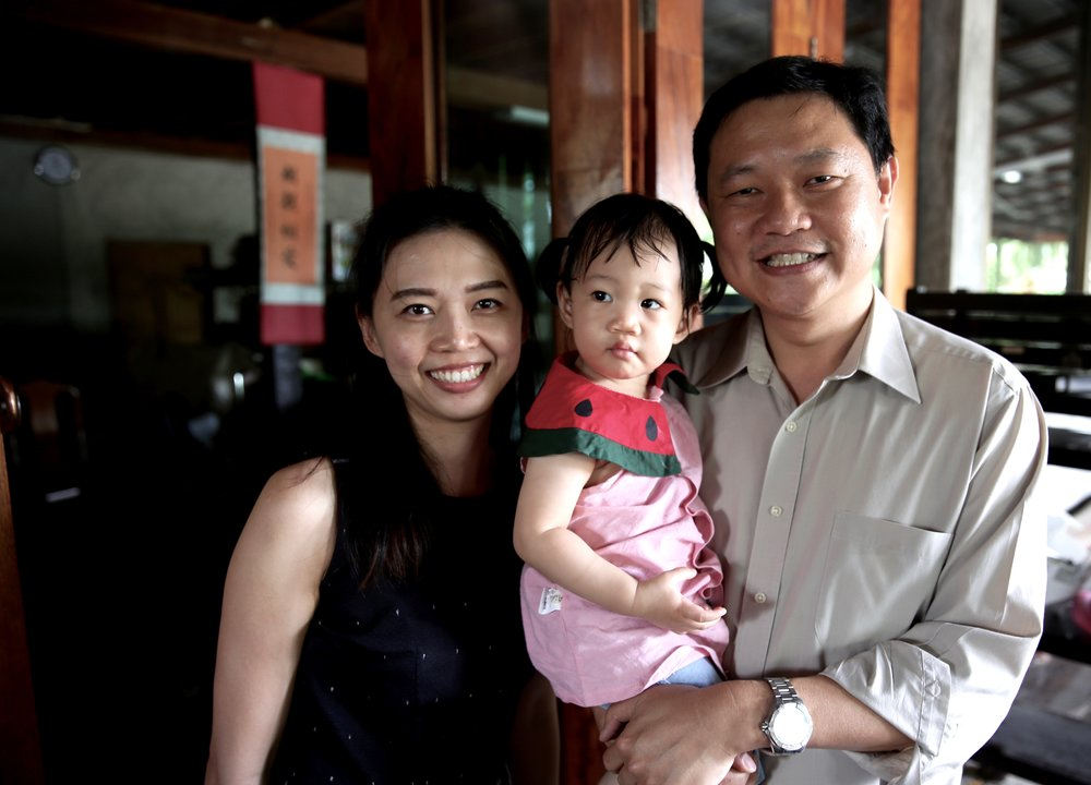 Wasan, his beautiful wife and their cute daughter. Her nickname is Mai which means silk in thai.