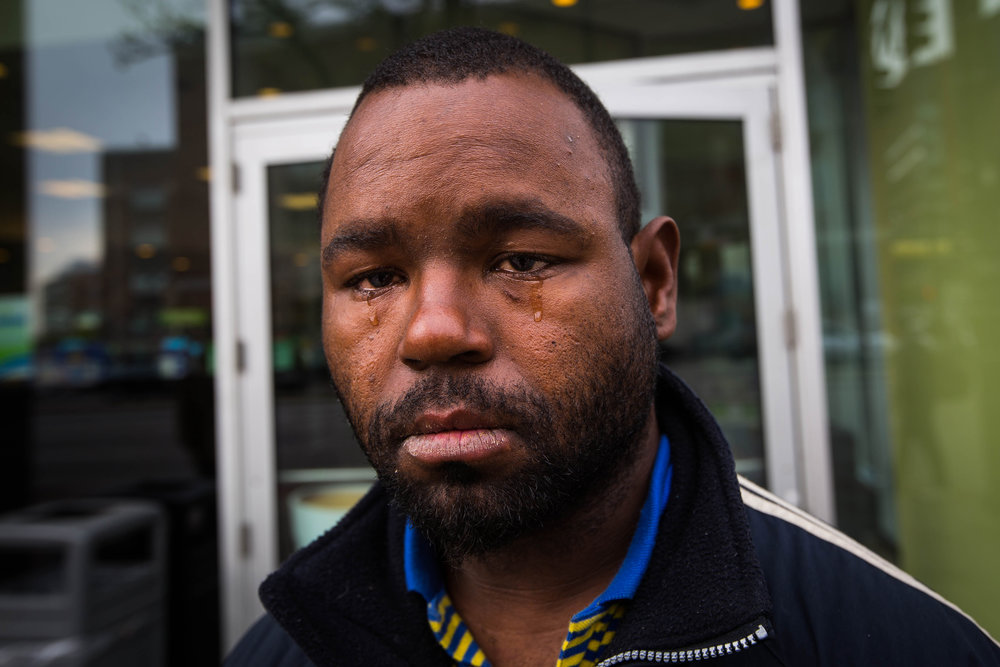"Terrance Moore, who calls himself Delicious, cries in front of the Cumberland Farms store on ""Methadone Mile"" as he talks about the years living on the streets in Boston. ""All I could ask for was to be loved, and I could never get it."" In a year or two, he says, he imagines he will be dead."