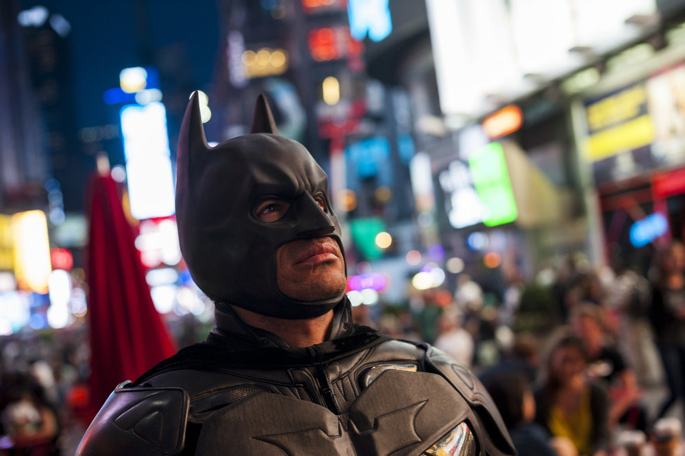 Jose looks out on the crowds in Times Square,  which after four years of portraying Batman, he considers his Gotham City.