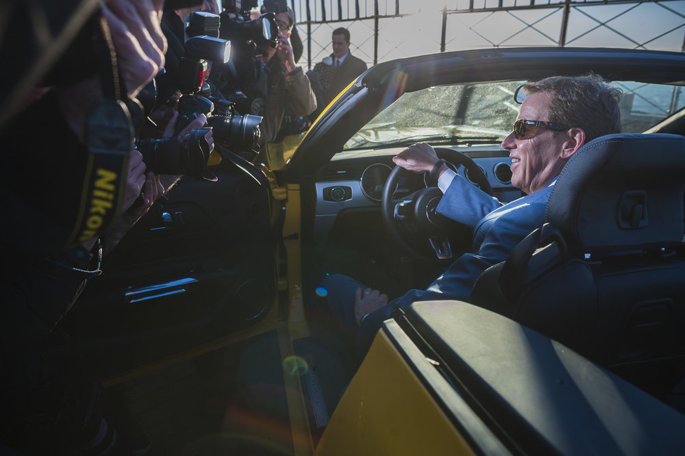 Ford Chairman Bill Ford sits behind the wheel of a 2015 Mustang GT during the car's unveiling on the observation deck of the Empire State Building in the Manhattan borough of New York.