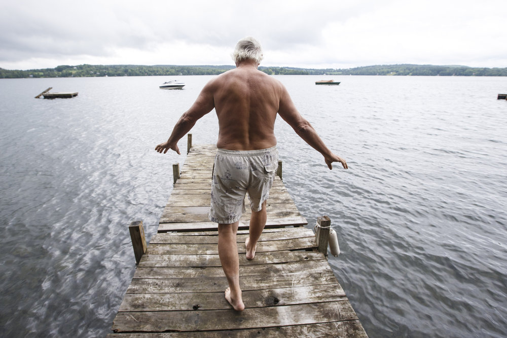 "Former Red Sox pitcher and candidate for Vermont Governor Bill ""Spaceman"" Lee walks out onto a dock to swim in the Caspian Lake in Greensboro, VT, August 17, 2016. The swim helps Lee, who still pitches in a senior league,  exercise his aging hip and knees."
