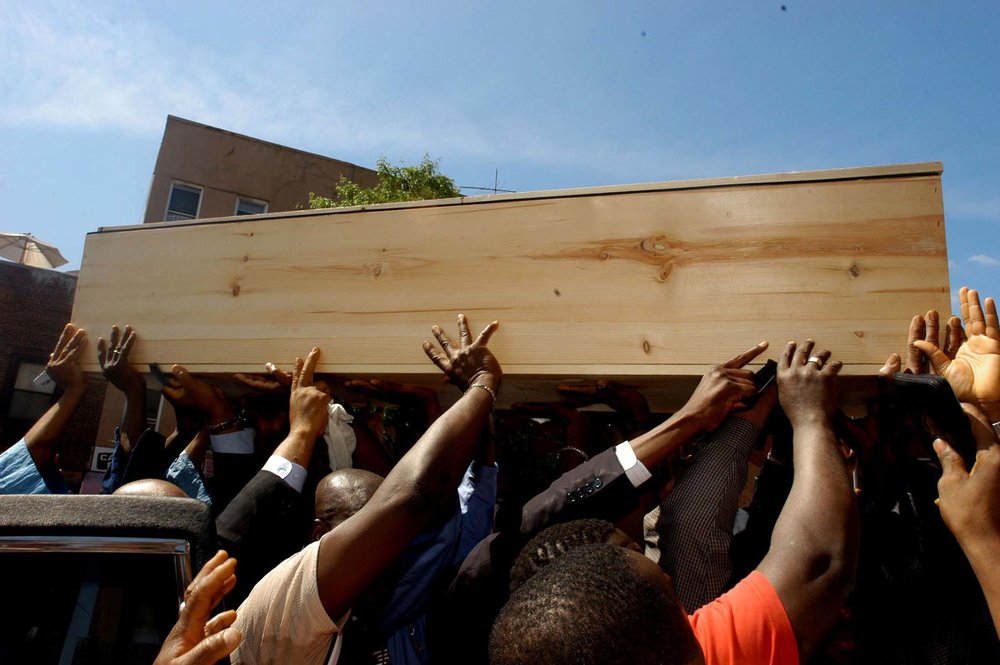 Mourners carry the coffin of African mmigrant Ousmane Zongo during his funeral  in New york City. Zongo was shot in killed by police in a raid of a warehouse where he had a store front.