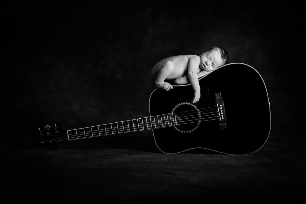 Hire a Professional - Do you think that baby was left unattended sleeping on this guitar??