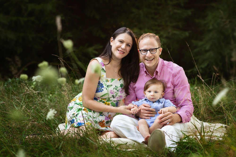 posed outdoor family photography session sitting on blanket