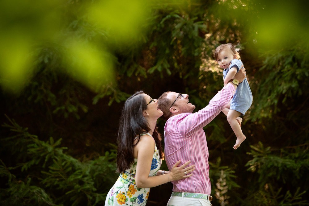 lifestyle outdoor family session in killingworth ct interacting with one year old boy