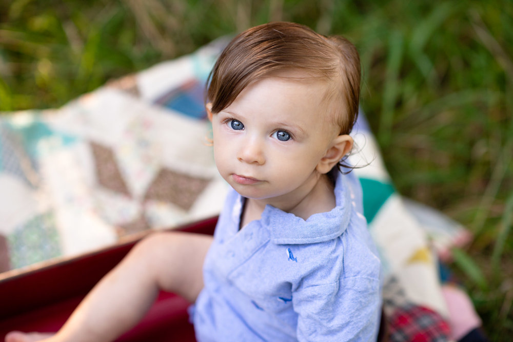 close up of one year old boy with blue eyes photo session shoreline, ct