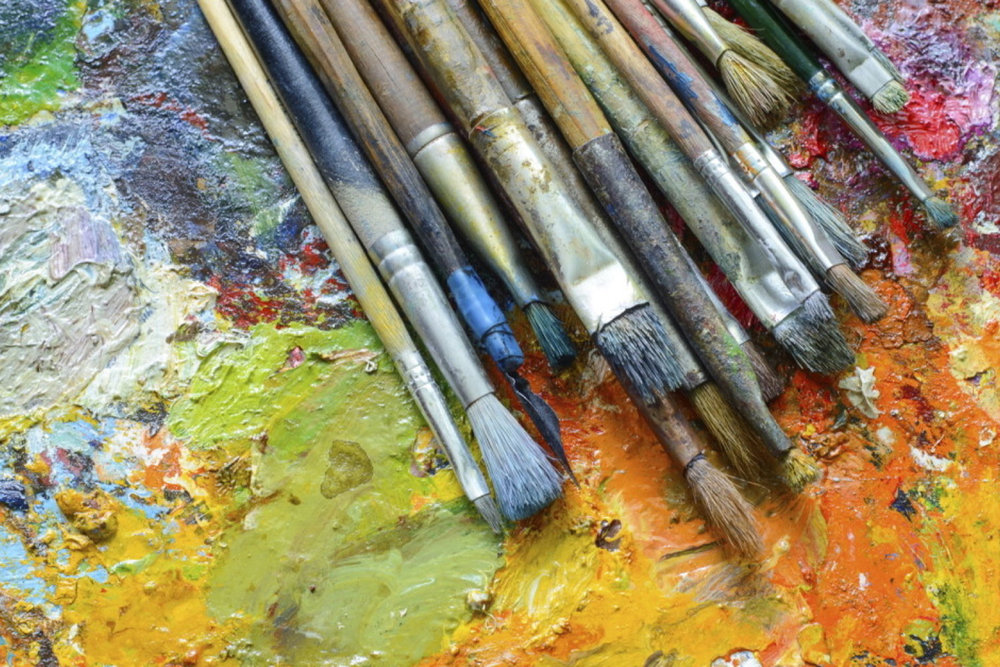 Brushes and supplies are provided for art workshop participants