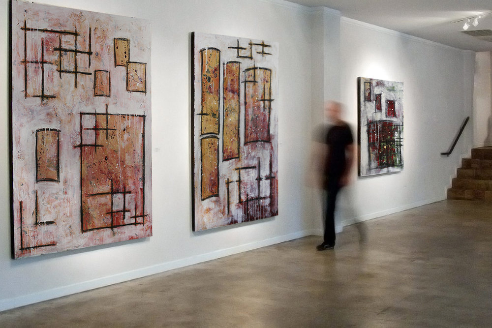 Abstract paintings hanging in hallway by artist Taylor Anne Smith.jpg