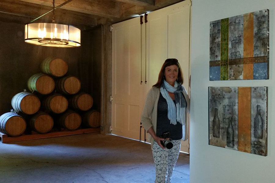 Artist Taylor Smith with several of her paintings in the Charles Krug Winery Collection