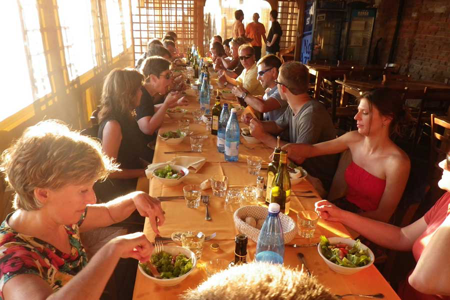 Participating artists and spouses enjoy a group dinner at one of our artist travel workshops in France