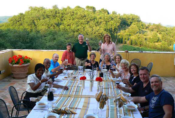 A group dinner on the final evening of an artist travel workshop in Italy. Taylor Smith's artist travel workshops bring artists and art lovers together for an intensive week of art instruction and workshop skills