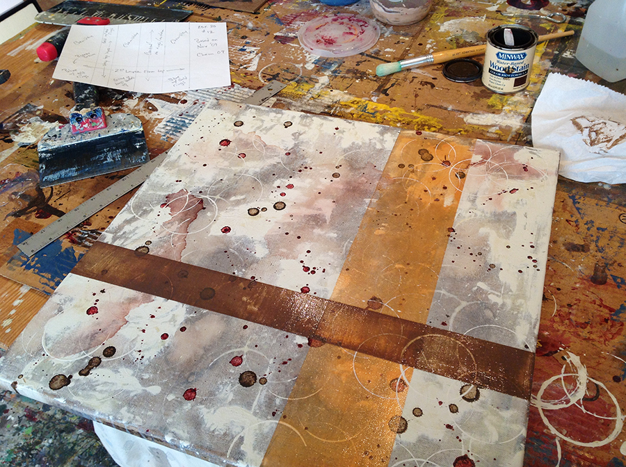 Abstract planes of golden tones on a canvas in progress by Taylor Smith from her wine themed chemical still life series